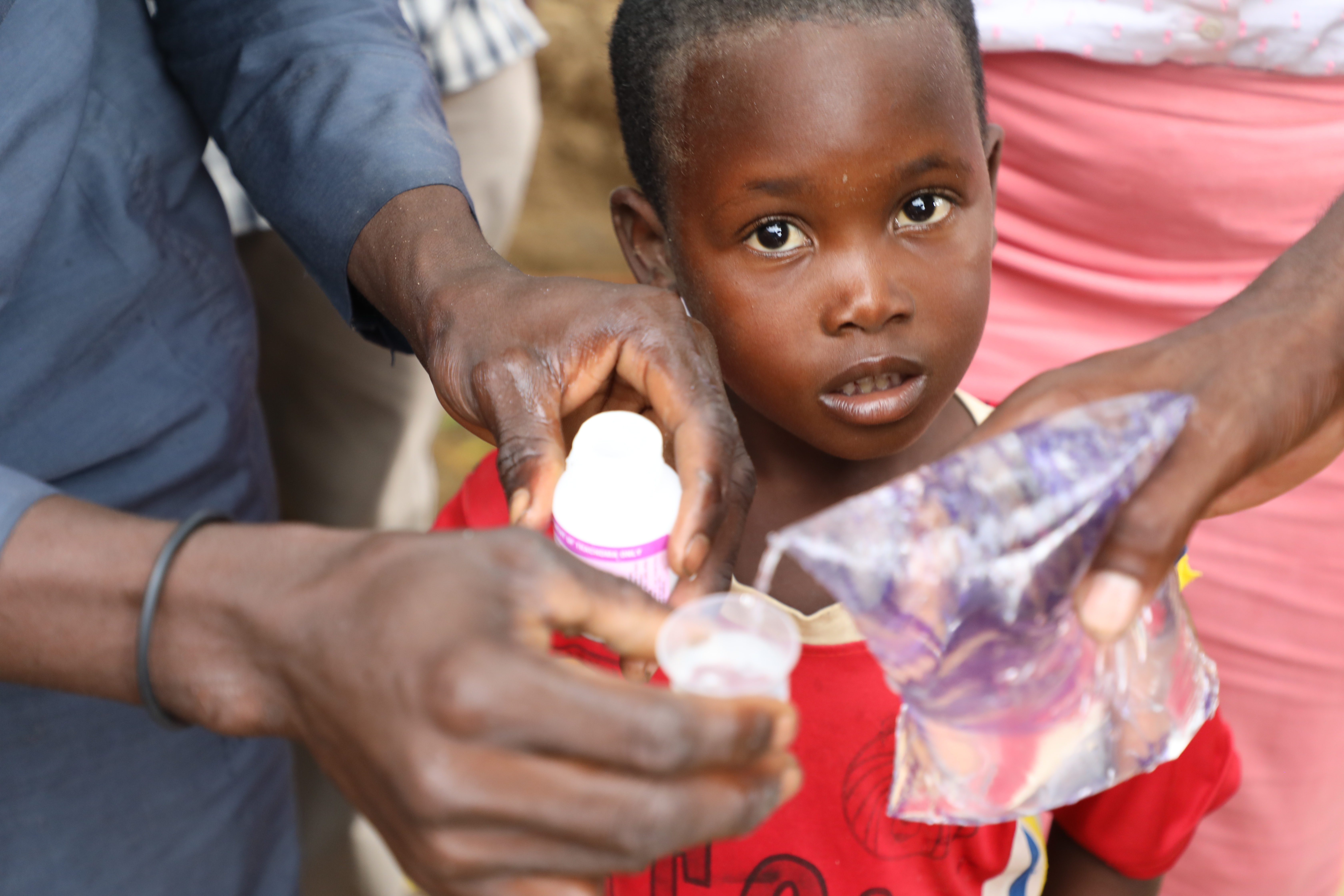 A child waiting to receive his dose of Zithromax® Powder for Oral Suspension (POS) at a Mass Drug Administration (MDA) in Sokoto State, Nigeria.